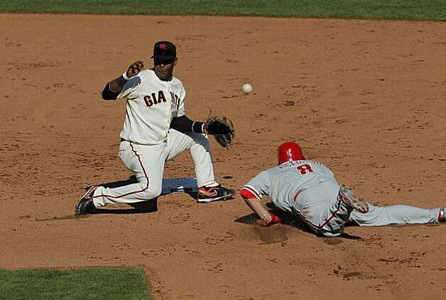 Philadelphia Phillies' Shane Victorino steals second base in the fifth inning under San Francisco Giants' Edgar Renteria during Game 3 of the National League Championship Series at AT&T Park on Tuesday, October 19, 2010 in San Francisco, Calif. Photo: Michael Macor, The Chronicle