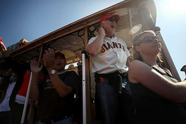 Ted Bonetti (top rt), of San Jose, watches from the trolly car at ATT&T park during game 3 of the National League Champion series with the San Francisco Giants and the Philadelphia Phillies on Tuesday Nov. 19, 2010 in San Francisco, Calif. Photo: Mike Kepka, The Chronicle