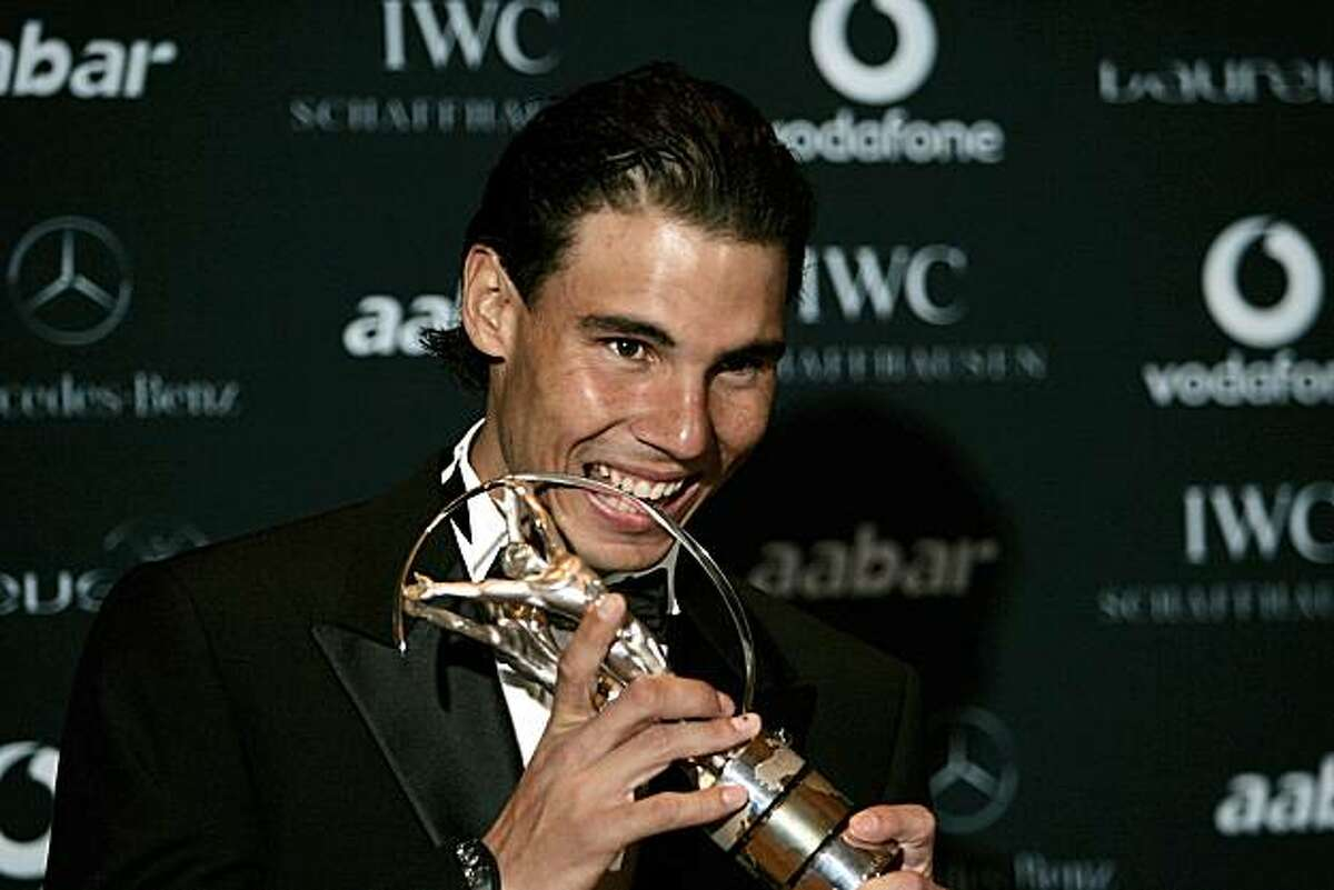 Rafael Nadal holds the trophy after winning the Laureus World Sportsman of the Year at the Laureus Awards in Abu Dhabi, United Arab Emirates, Monday Feb. 7, 2011.