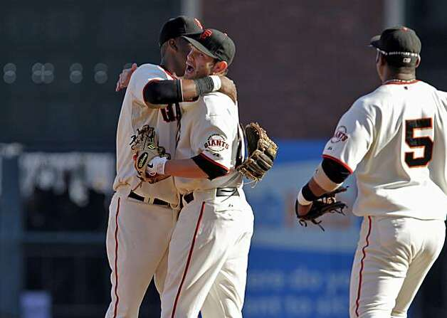 San Francisco Giants  Edgar Renteria hugs Freddy Sanchez, after the Giants defeat the Philadelphia Phillies 3 to 0 in Game 3 of the National League Championship Series, Tuesday Oct. 19, 2010, at AT&T Park in San Francisco, Calif. Photo: Lacy Atkins, The Chronicle