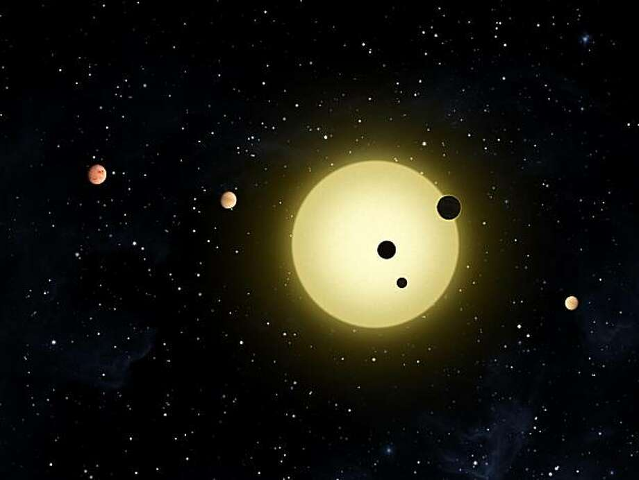 """This is a NASA illustration of the newly discovered 6-planet """"solar system"""" around a sun-like star 2000 light years away. Photo: Nasa, NASA"""