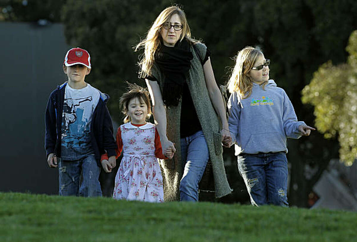 Annie Bauccio Moore and her children Charlie, 7-years-old, Drew, 4-years old and Jessie, 9-years-old, at Duboce Park in San Francisco, Ca., on Tuesday Feb. 1, 2011. Their family qualified for state's Assistance to Mothers and Infants when she had her second child but now they no longer eligible for assistance because they make to much money and now pay about $1,700 a month for health coverage.