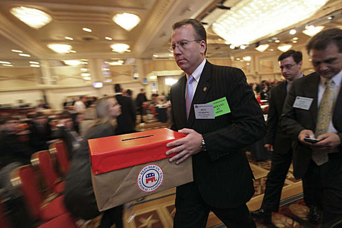 Sergeant at Arms Ron Nehring carries the ballot box to be tallied during elections at the RNC winter meetings in Washington, Friday, Jan. 30, 2009. Former Maryland Lt. Gov. Michael Steele was elected the first black Republican National Committee chairman in an election by the RNC, beating back four challengers, including incumbent Mike Duncan. (AP Photo/Pablo Martinez Monsivais)