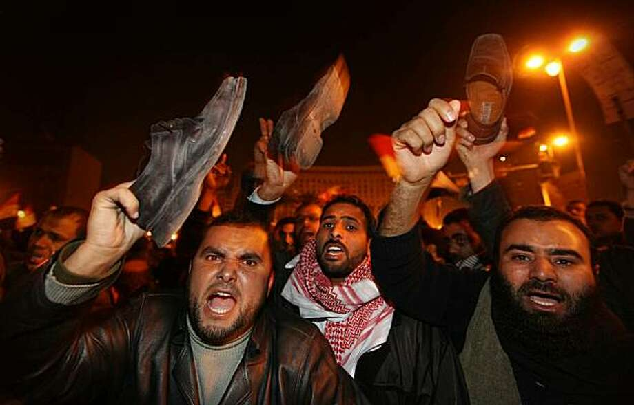 CAIRO, EGYPT - FEBRUARY 01:  Anti-government protestors waves their shoes, in a gesture of anger, after President Hosni Mubarak announces that he will not seek re-election on February 1, 2011 in Cairo, Egypt. Protests in Egypt continued with the largest gathering yet, with many tens of thousands assembling in central Cairo, demanding the ouster of Egyptian President Hosni Mubarek. The Egyptian army has said it will not fire on protestors as they gather in large numbers in central Cairo. Photo: Peter Macdiarmid, Getty Images