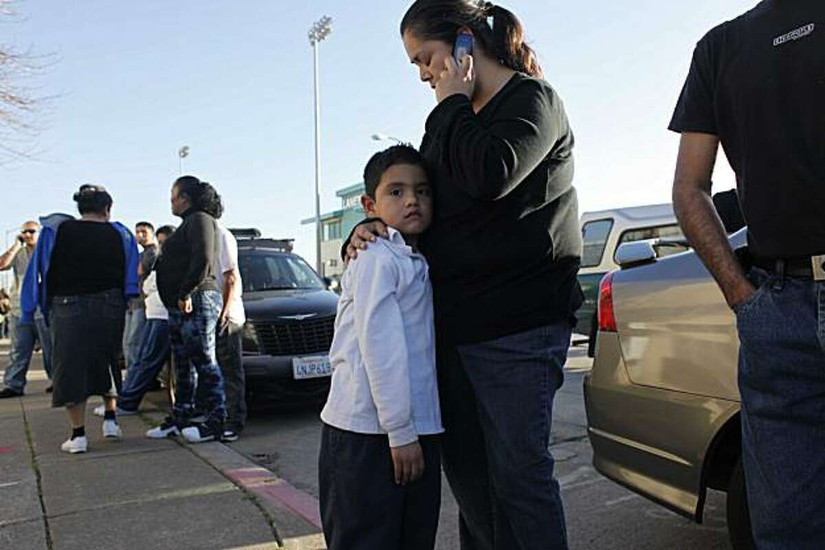 Jorge Moreno, 5, a student at La Escuelita Elementary school, receives a hug from his mother, Marta Moreno, after a campus lockdown Monday.