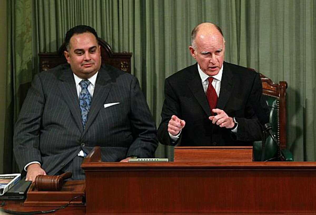 SACRAMENTO, CA - JANUARY 31: California Governor Jerry Brown (R) delivers the State of the State address as Speaker of the Assembly John Perez (L) looks on at the California State Capitol on January 31, 2011 in Sacramento, California. One month after taking office, Gov. Brown delivered the State of the State address to a joint session of the California State legislature.