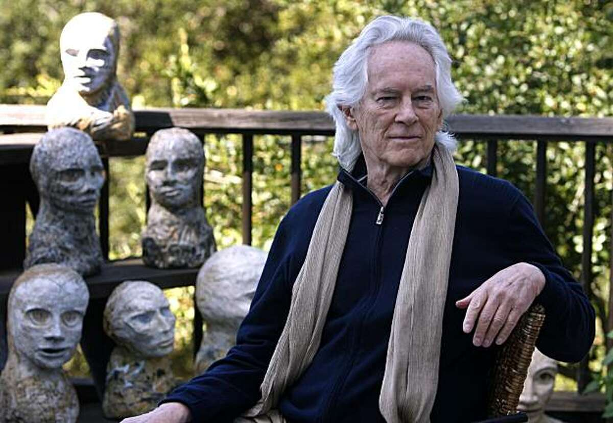 Beat poet Michael McClure is seen on his deck with sculptures by his wife, artist Amy Evans McClure, at their home in Oakland, Calif., on Thursday, Sept. 16, 2010.