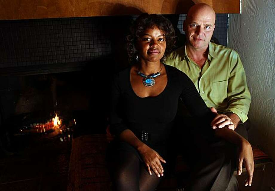 Chanda Williams and JŸrgen Mšllers use the fireplace for the first time in their new home in Montclair, Calif., on Thursday, January 20, 2011. Photo: Liz Hafalia, The Chronicle