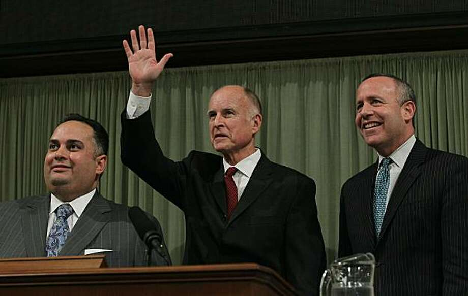 SACRAMENTO, CA - JANUARY 31:  California Governor Jerry Brown (C) waves to the crowd before delivering the State of the State address as Speaker of the Assembly John Perez (L) and Senate President Pro Tem Darrell Steinberg (R) look on at the California State Capitol on January 31, 2011 in Sacramento, California. One month after taking office, Gov. Brown delivered the State of the State address to a joint session of the California State legislature. Photo: Justin Sullivan, Getty Images