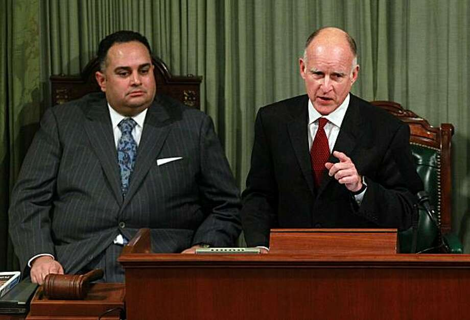 SACRAMENTO, CA - JANUARY 31:  California Governor Jerry Brown (R) delivers the State of the State address as Speaker of the Assembly John Perez (L) looks on at the California State Capitol on January 31, 2011 in Sacramento, California. One month after taking office, Gov. Brown delivered the State of the State address to a joint session of the California State legislature. Photo: Justin Sullivan, Getty Images
