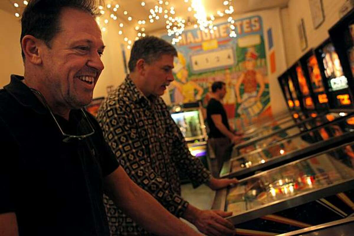Michael Schiess, left and Larry Zartarian play pinball at the Pacific Pinball Museum, Tuesday January 25, 2011, in Alameda, Calif.