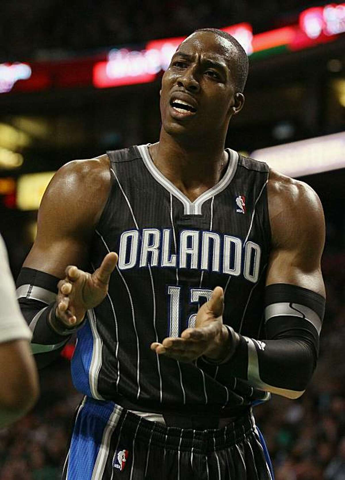 BOSTON, MA - JANUARY 17: Dwight Howard #12 of the Orlando Magic reacts to a call in the first quarter as they take on the Boston Celtics on January 17, 2011 at the TD Garden in Boston, Massachusetts. NOTE TO USER: User expressly acknowledges and agreesthat, by downloading and/or using this Photograph, User is consenting to the terms and conditions of the Getty Images License Agreement.