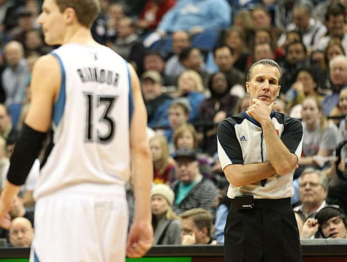 Referee Ken Mauer, right, watches three throws during a spree of five technicals he called against the Minnesota Timberwolves during the second half of an NBA basketball game between the Timberwolves and the San Antonio Spurs on Tuesday, Jan. 11, 2011, inMinneapolis. The Spurs won 107-96. At left is Timberwolves' Luke Ridnour.