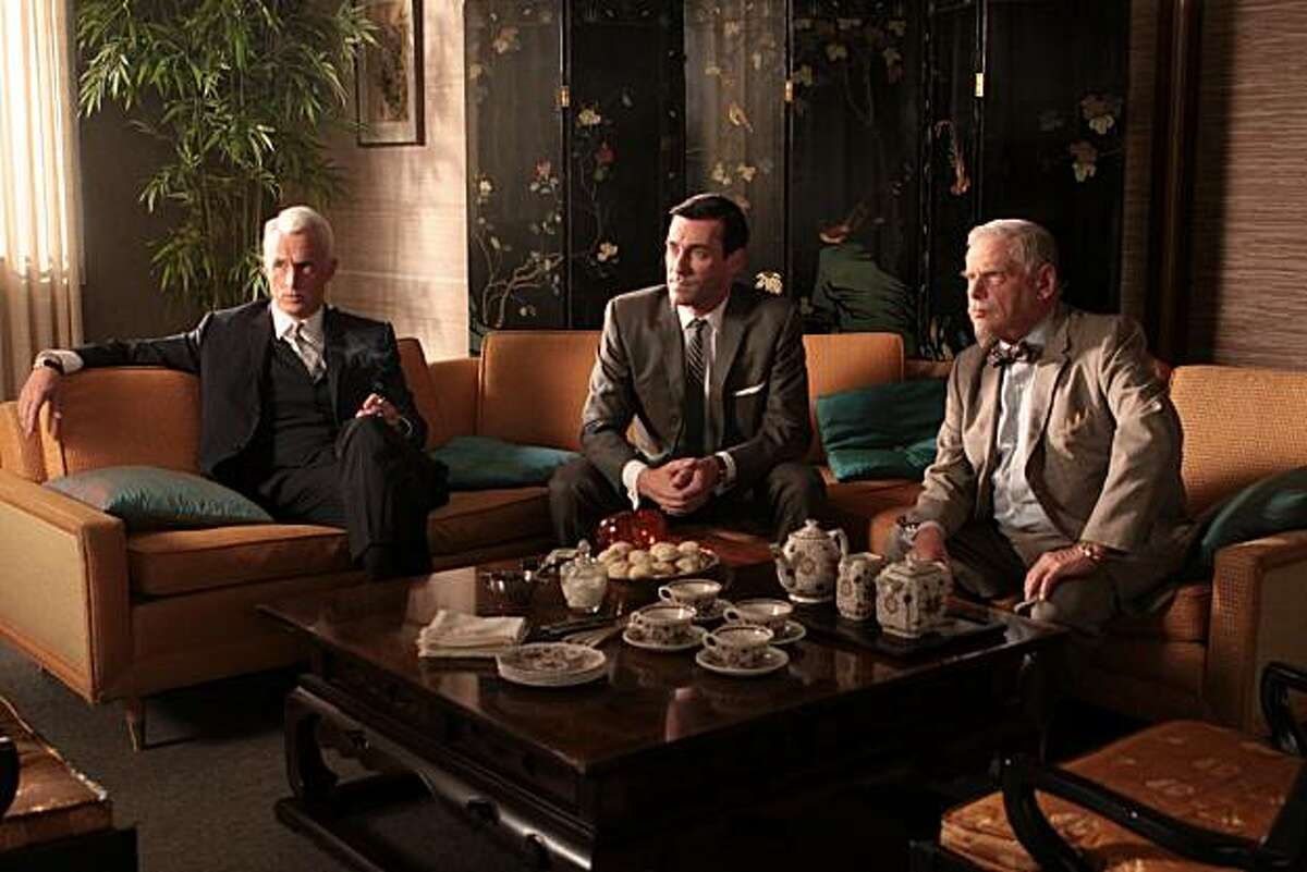 Roger Sterling (John Slattery), Don Draper (Jon Hamm) and Bertram Cooper (Robert Morse) discusses the possibility of repurchasing Sterling Cooper from its British owners in AMC's Mad Men.