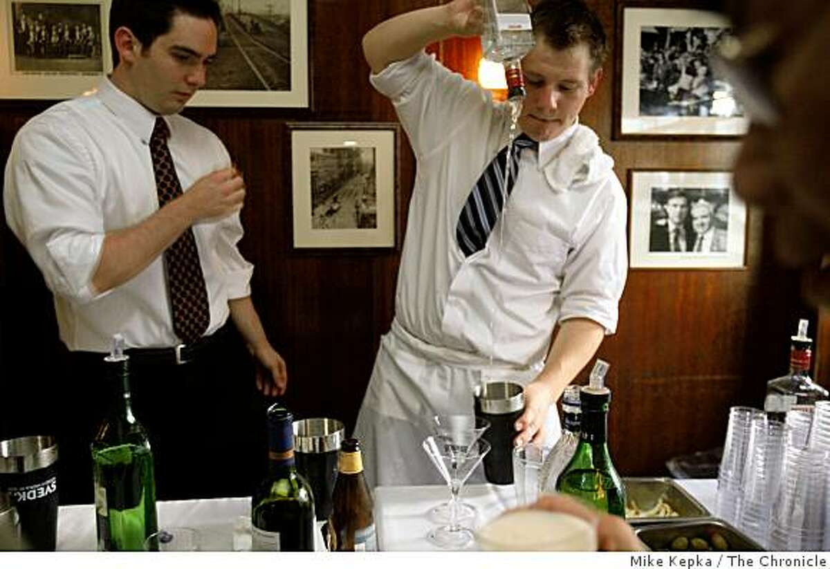 Bartenders work at John's Grill for the famed San Francisco restaurant's celebration of its centennial on Nov. 11, 2008 in San Francisco, Calif.