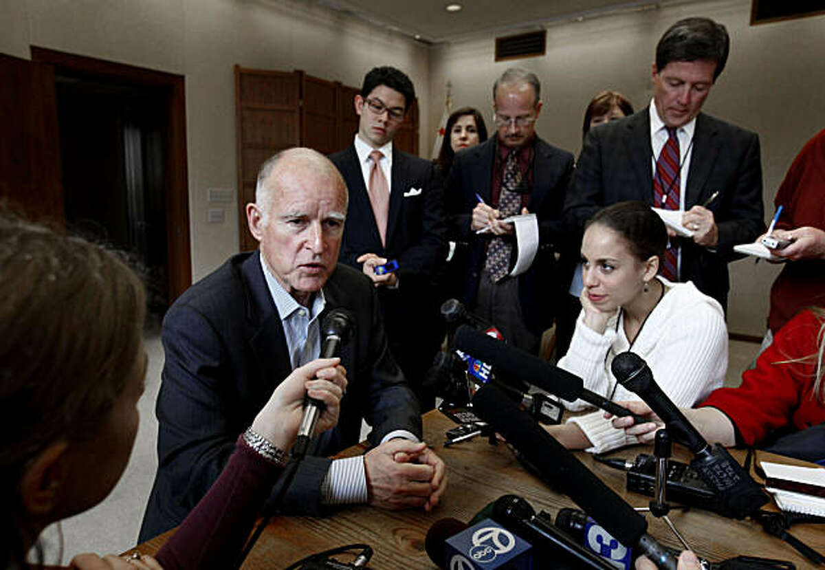 Gov. Jerry Brown talks with reporters about the state budget during a news conference held in his Capitol office in Sacramento, Calif., Wednesday, Jan. 26, 2011. Later in the day Brown will meet with the mayors of several of the state's largest citiesto discuss his proposal to eliminate redevelopment agencies to help solve the budget deficit.