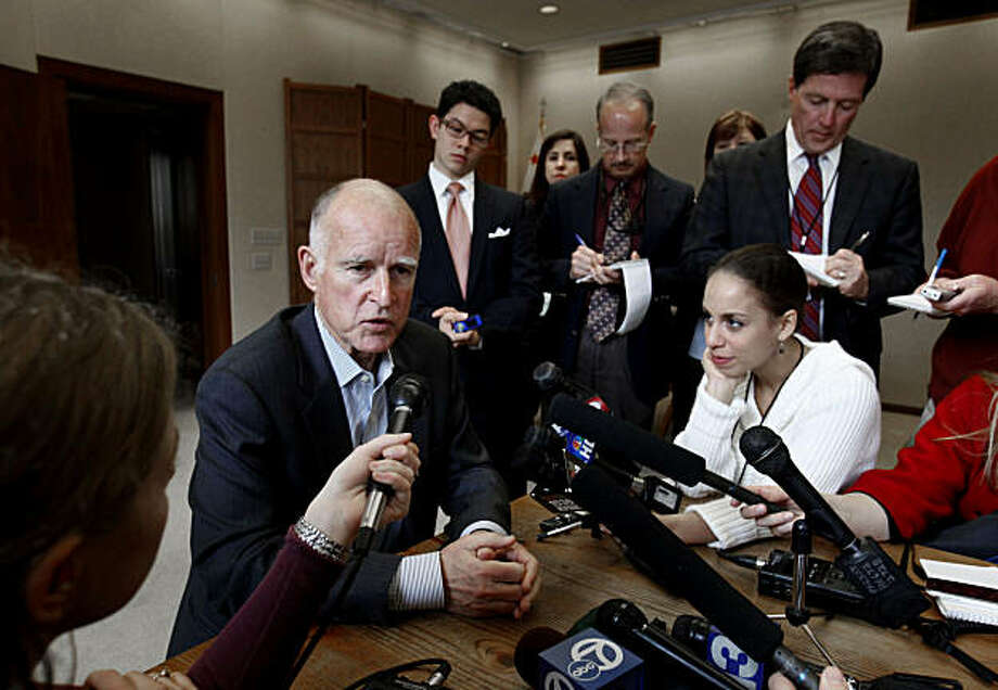 Gov. Jerry Brown talks with reporters about  the state budget during a news conference held in his Capitol office in Sacramento, Calif., Wednesday,  Jan. 26, 2011.  Later in the day Brown will meet with the mayors of several of the state's largest citiesto discuss his proposal to eliminate redevelopment agencies to help solve the budget deficit. Photo: Rich Pedroncelli, AP