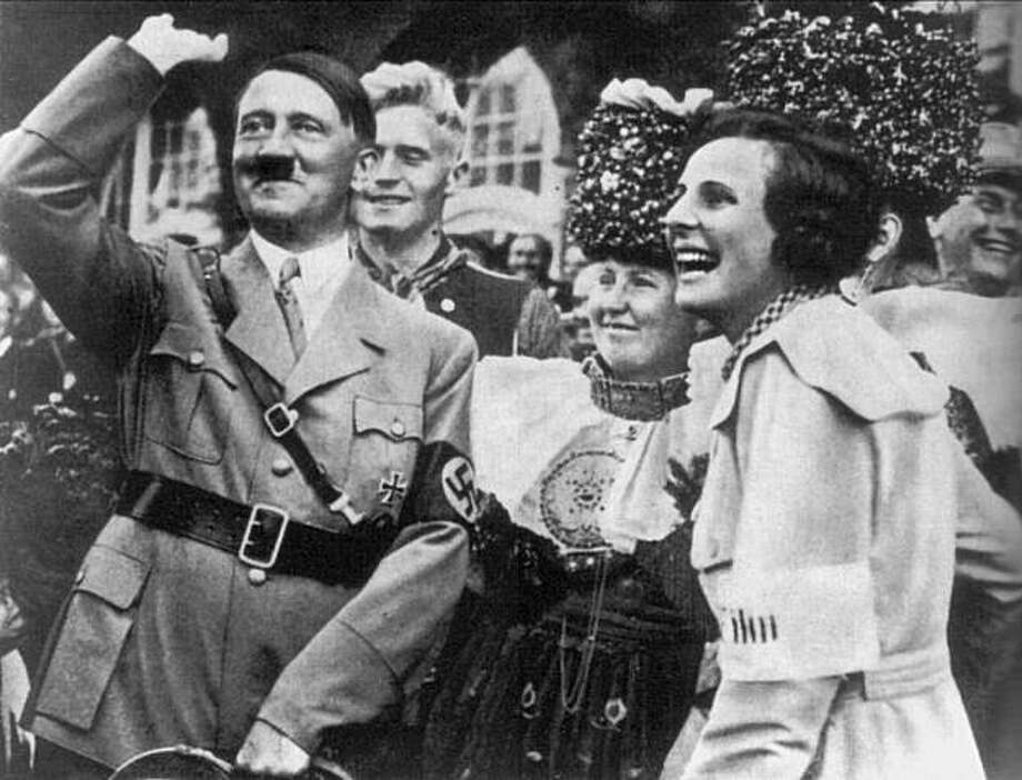 "Caption from the book: ""On the best of terms: Leni Riefenstahl and Adolf Hitler on the sidelines during the filming of 'Triumph of the Will' in 1934.""  Credit: Drama Department Archives of the University of Cologne, From ""Leni Riefenstahl: A Life""  FOR USE WITH BOOK REVIEW ONLY  Ran on: 03-25-2007  HITLER AND RIEFENSTAHL, AT TOP, DURING FILMING OF &quo;TRIUMPH OF THE WILL'' IN 1934; RIEFENSTAHL SHOOTING &quo;OLYMPIA&quo; IN 1936, ABOVE.  Ran on: 04-15-2007  Leni Riefenstahl on the set of &quo;Triumph of the Will&quo; in 1934: Who knew?  ALSO Ran on: 04-29-2007  Adolf Hitler, joined by his propagandizing moviemaker Leni Riefenstahl (right), during the filming of &quo;Triumph of Will.&quo; Such obvious propaganda eventually leads to disbelief and hostility. Photo: University Of Cologne Archives"