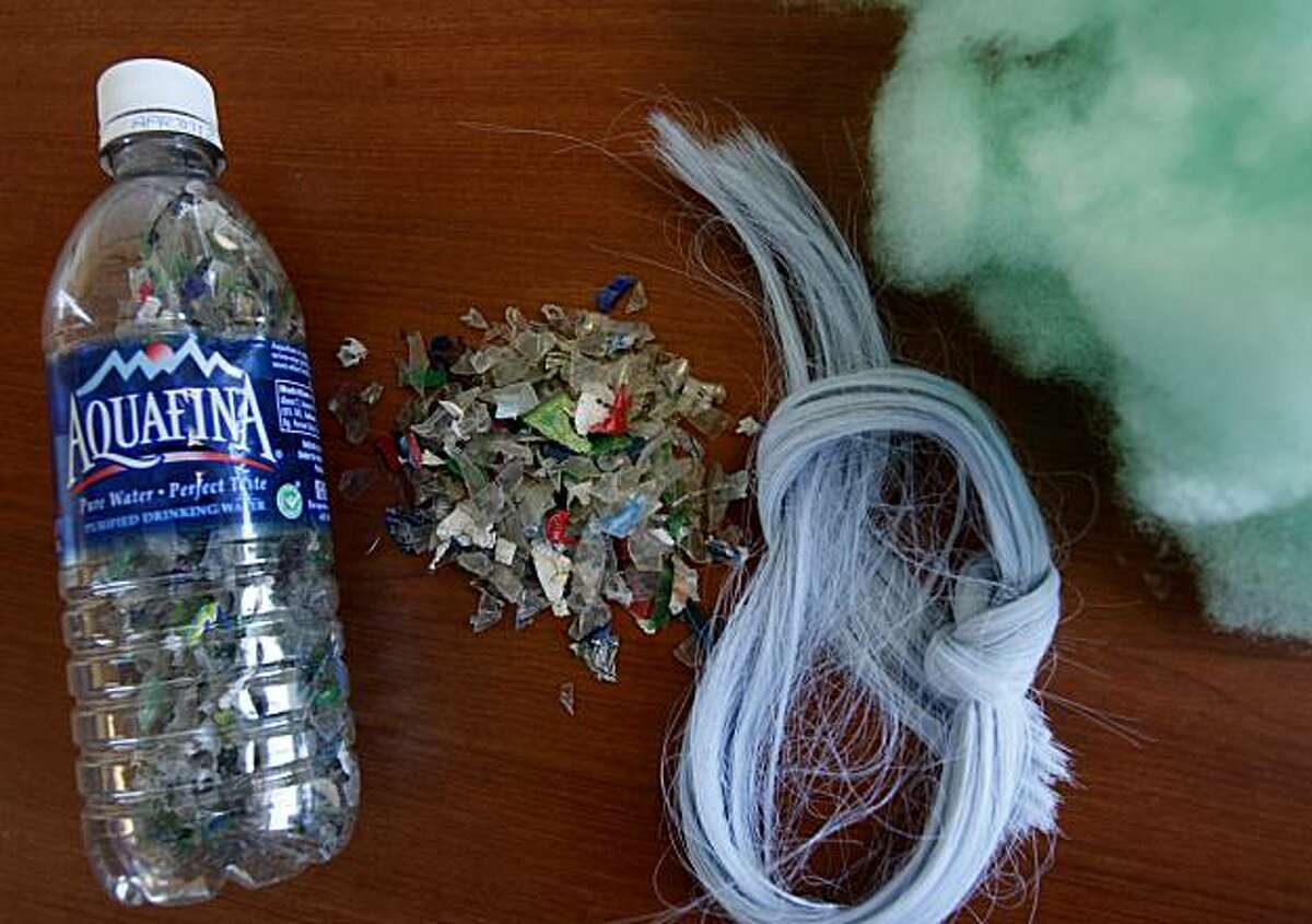 The products that go into the recycled filling for dog beds. Plastic bottles, many from Walmart (left), are turned into small chips, and then a string like product is turned into the final filling (far right). Worldwise, which has an office in San Rafael, Calif., makes pet products out of recycled materials some of which come from retailer Walmart.