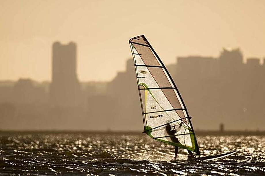 A windsurfer surfs in San Francisco Bay near along Robert W. Crown Memorial State beach in Alameda, Calif. on Tuesday, Aug. 4, 2009. Photo: Stephen Lam, The Chronicle