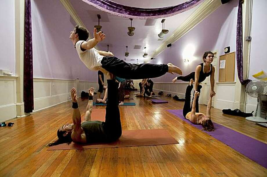 Miguel Balderrama supports Zach Cohen during a flying yoga class at the Yoga Tree July 31, 2009 in San Francisco, Calif. Photo: David Paul Morris, Special To The Chronicle