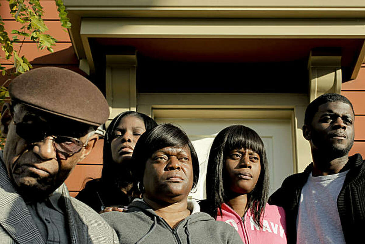 (left to right) Bishop Joseph Jenkins, is joined by family members Kenya Bingham, (daughter), Kathy Bingham, (ex-wife), Jovon Bingham, (daughter), Brian Bingham, (son), on Wednesday Jan. 26, 2011 in Oakland, Ca., as they appeal for help in solving the murder of Berresford