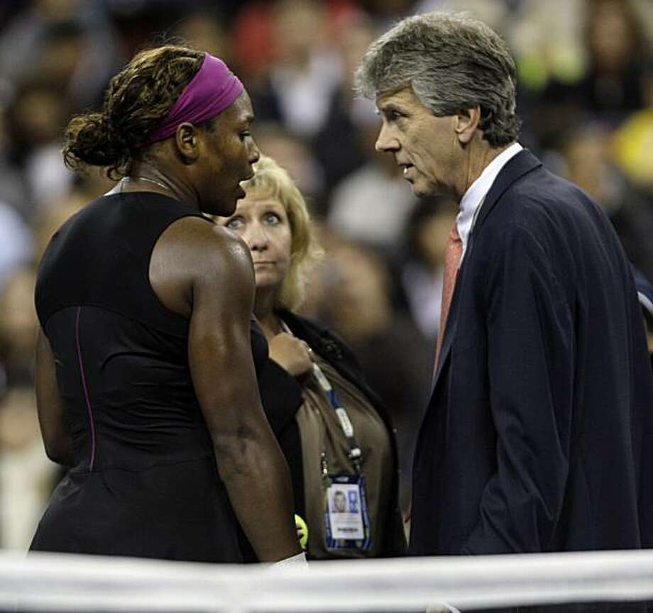 Serena Williams, of the United States, left, talks to officials after arguing with a line judge over a foot fault during her match against Kim Clijsters, of Belgium, at the U.S. Open tennis tournament in New York, Saturday, Sept. 12, 2009. Clijsters defeated Williams in two sets. Photo: Charles Krupa, AP