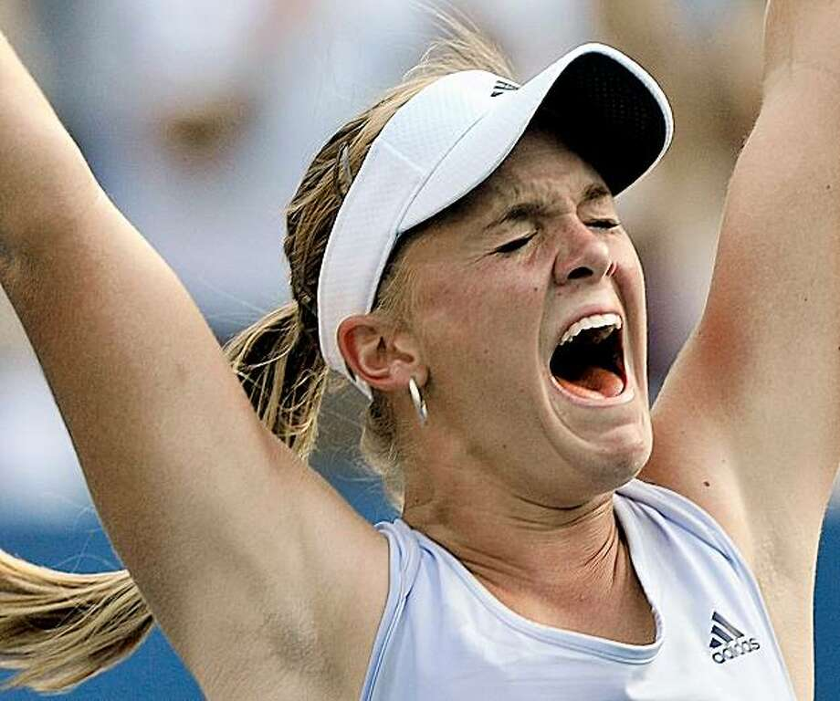 Melanie Oudin of the United States celebrates her upset victory over Maria Sharapova of Russia during the third round of the U.S. Open tennis tournament in New York, Saturday, Sept. 5, 2009. Oudin won 3-6, 6-4, 7-5. (AP Photo/Paul J. Bereswill) Photo: Paul J. Bereswill, AP
