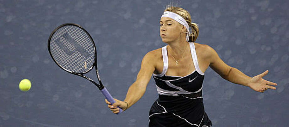 Maria Sharapova, of Russia, returns a shot to Tsvetana Pironkova, of Bulgaria, during the first round of the U.S. Open tennis tournament in New York, Tuesday, Sept, 1, 2009. (AP Photo/Darron Cummings) Photo: Darron Cummings, AP