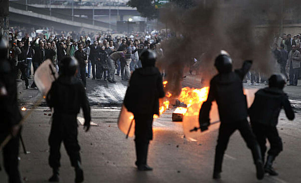 Egyptian riot police clash with anti-government activists in Cairo, Egypt, Wednesday, Jan. 26, 2011. Egyptian anti-government activists clashed with police for a second day Wednesday in defiance of an official ban on any protests but beefed up police forces on the streets quickly moved in and used tear gas and beatings to disperse demonstrations.