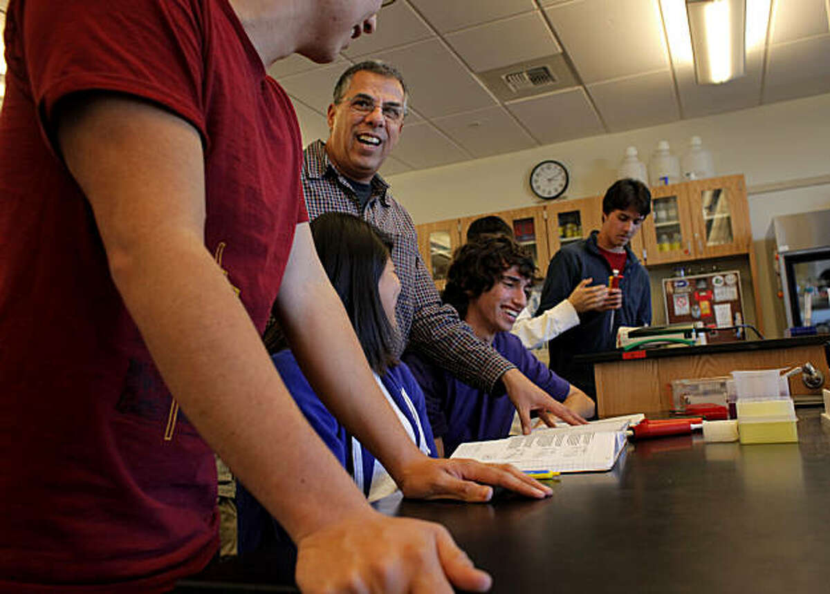 Teacher George Cachianes, center, instructs the seniors, Ricardo Mejia, left, Mary Roque and Mark Solovey, in the Biotech class at the Lincoln High School, Tuesday January 25, 2011, in San Francisco, Calif.