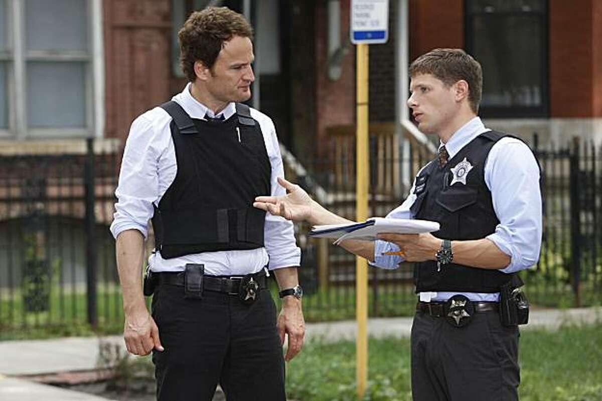THE CHICAGO CODE: Jarek (Jason Clarke, L) and Caleb (Matt Lauria, R) investigate a crime scene in the