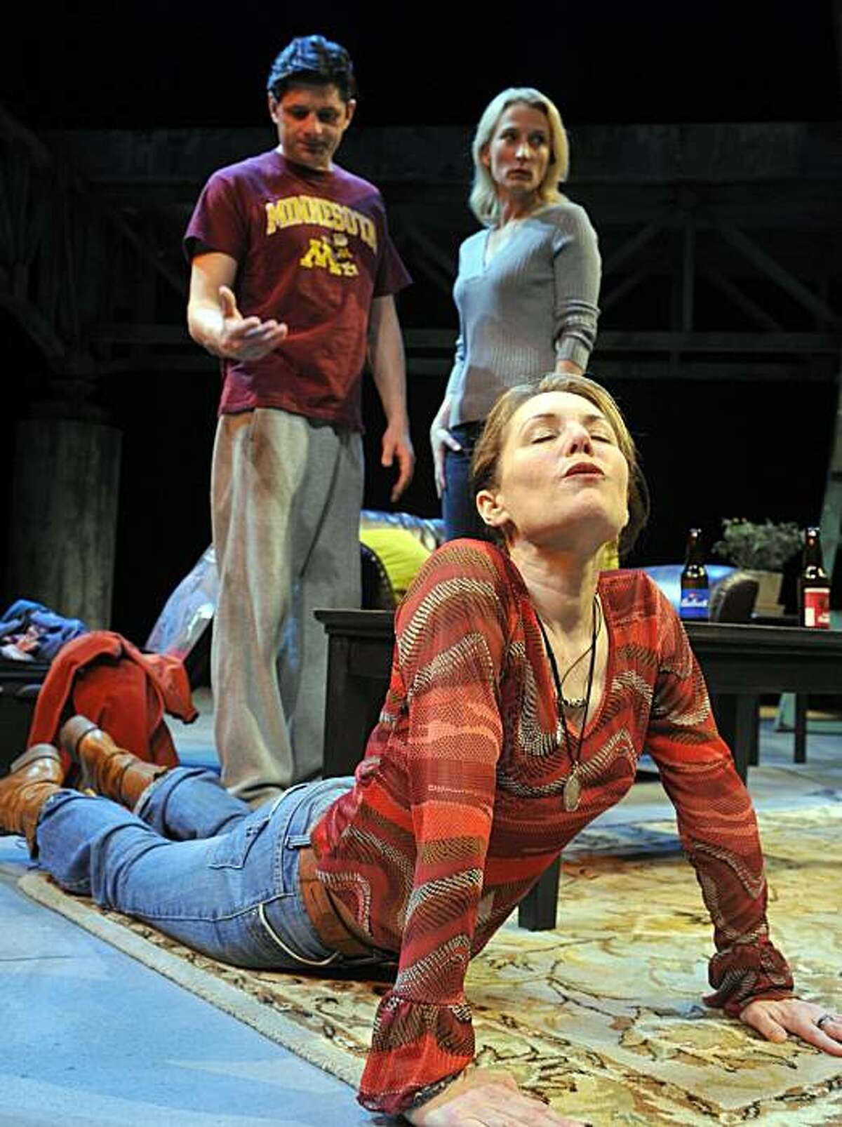 David (Gabriel Marin) and Hannah (Carrie Paff) confront the unexpected arrival of Susan (Amy Resnick, front) in Aurora Theatre's world premiere of Allison Moore's