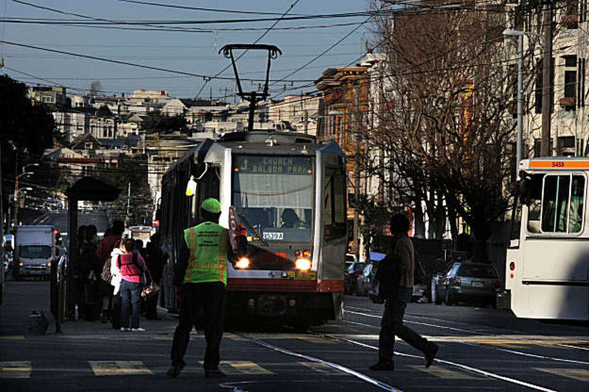 The J-Church streeetcar picking up passengers at 16th on Church streets in San Francisco, Calif., on Tuesday, January 25, 2011. Supervisor Scott Wiener is trying to resove the J line's inconsistent train frequency and inaccurate GPS tracking.