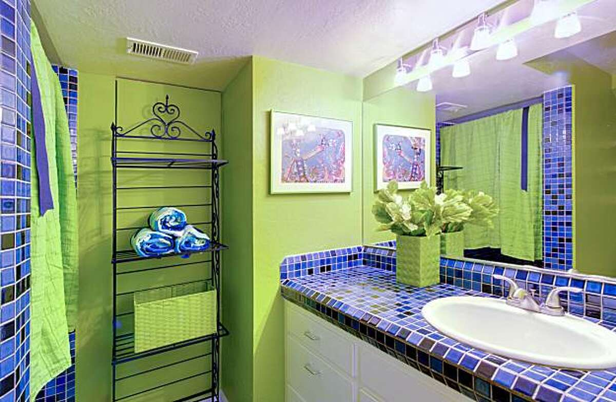 This Mediterranean-style home has two full bathrooms.
