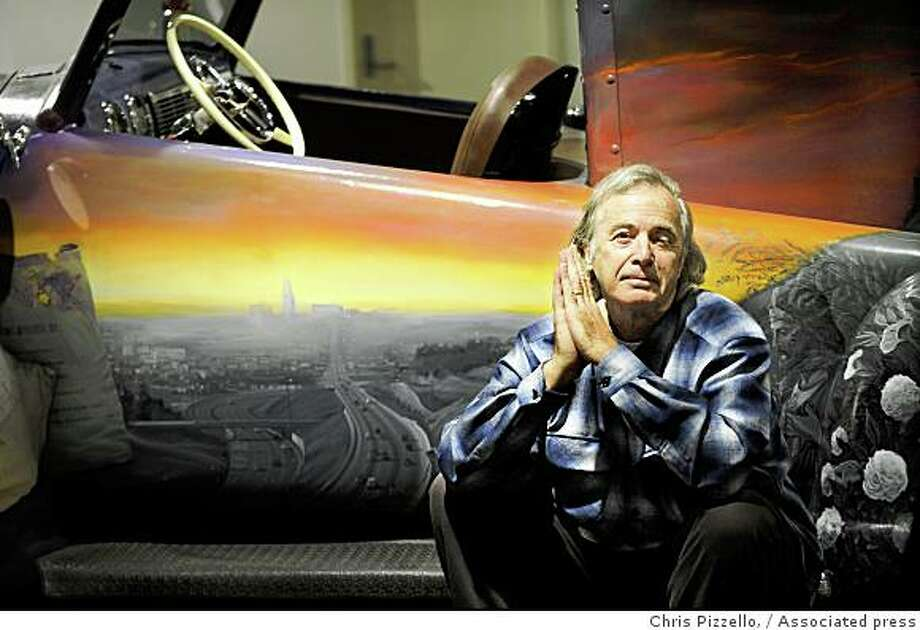 Musician Ry Cooder poses alongside a custom-built ice cream truck commissioned by him and featuring a mural of Los Angeles' Chavez Ravine by artist Vincent Valdez, at the Petersen Automotive Museum in Los Angeles, Thursday, July 10, 2008. Photo: Chris Pizzello,, Associated Press