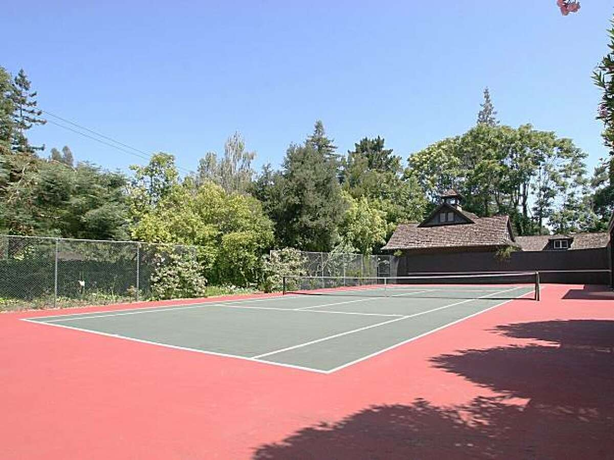 The Atherton property's two-acre lot includes a tennis court with a pavilion and garden.