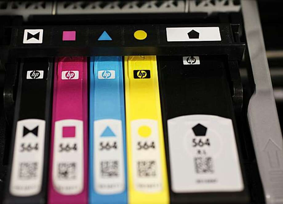 Hewlett Packard printer inks are seen inside an HP printer on display at Best Buy in Mountain View, Calif., Monday, May 18, 2009. Hewlett-Packard Co. on Tuesday said its quarterly profit dropped 17 percent as sales of personal computers and printer ink slumped. The numbers were still in line with Wall Street's forecasts. (AP Photo/Paul Sakuma) Photo: Paul Sakuma, AP
