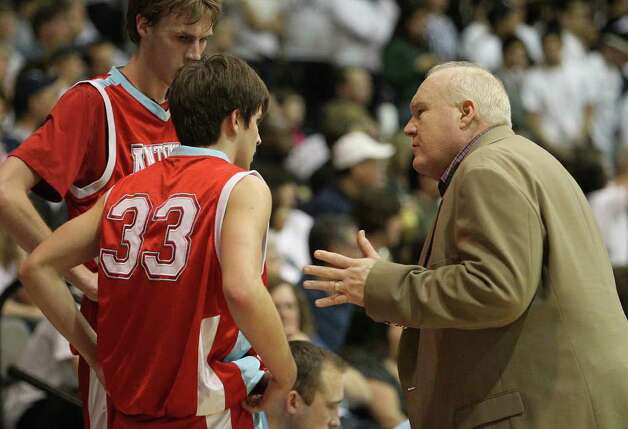 Antonian basketball coach Charlie Boggess (right) instructs players Chris Molina (33) and Jerred Kite during their game against Central Catholic in boys basketball at Greehey Arena at St. Mary's University on Wednesday, Jan. 11, 2012. Photo: KIN MAN HUI, ~ / SAN ANTONIO EXPRESS-NEWS
