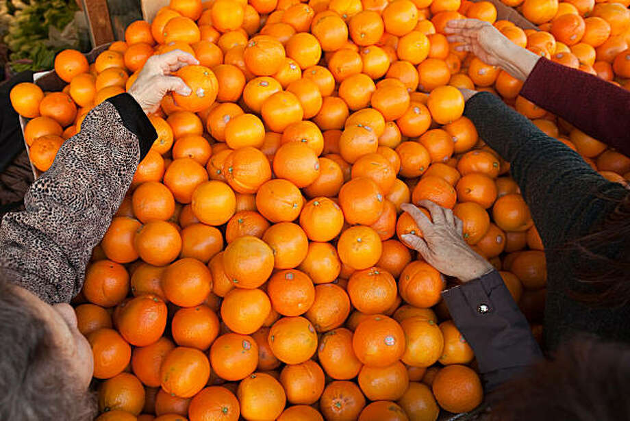 Customers shop for oranges in Chinatown on January 31, 2011 in San Francisco, California.  Photograph by David Paul Morris/Special to the Chronicle Photo: David Paul Morris, Special To The Chronicle