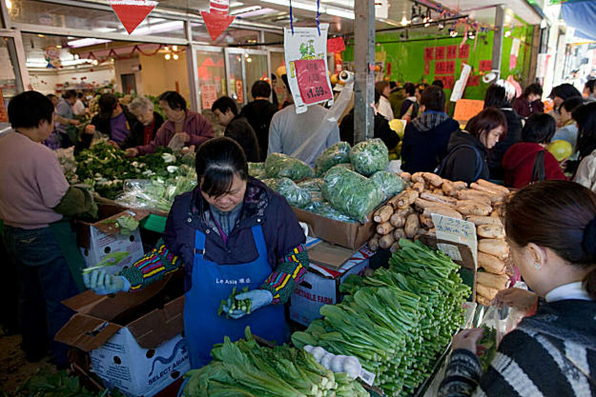 Customers shop for produce City Super Supermarket in Chinatown on January 31, 2011 in San Francisco, California. Photograph by David Paul Morris/Special to the Chronicle