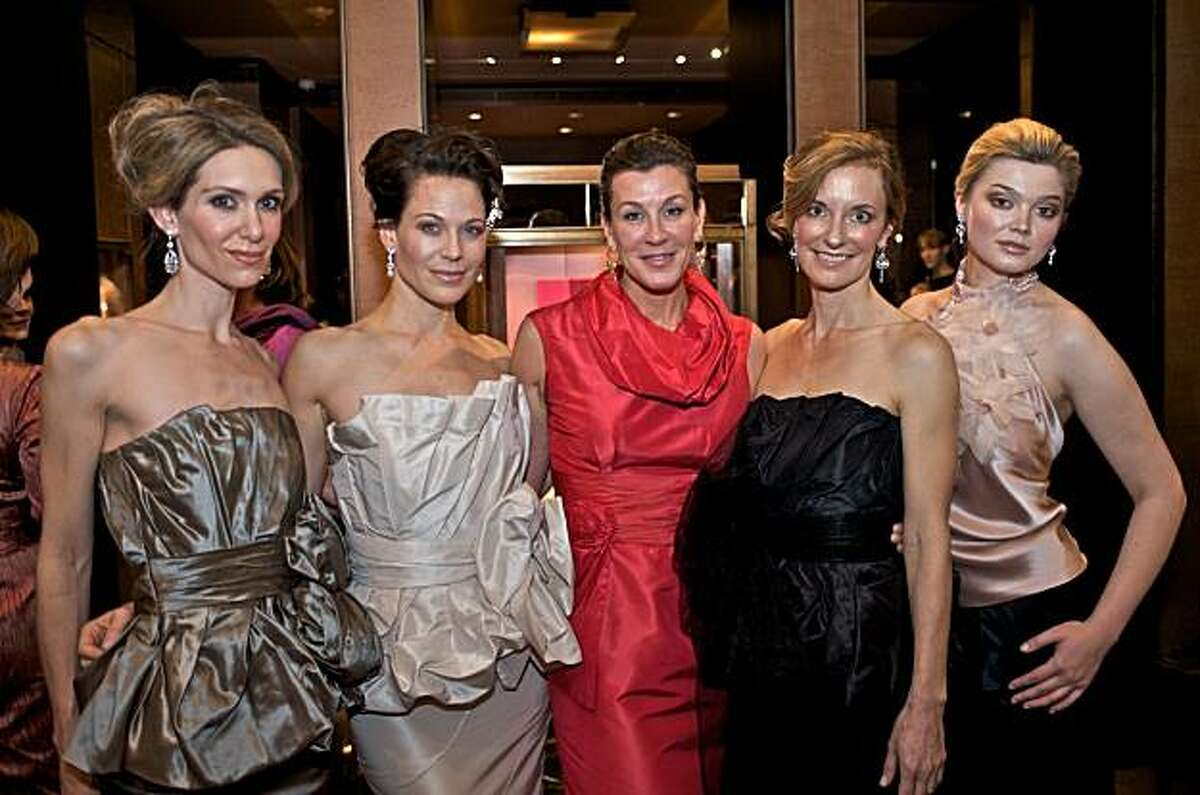 Clothing designer Julia Panciroli, a native of Scotland, lives and works in San Francisco, making her own line of made-to-measure upscale clothing for women. Her latest collection debuted at a party at the Boucheron jewelry boutique on Dec. 14, 2010. Here, from left to right (with Panciroli in red): Nikki Haramoglis, Sherri Siegel, Julia Panciroli, Ruth Krumbhaar and Ukushu Krystyna