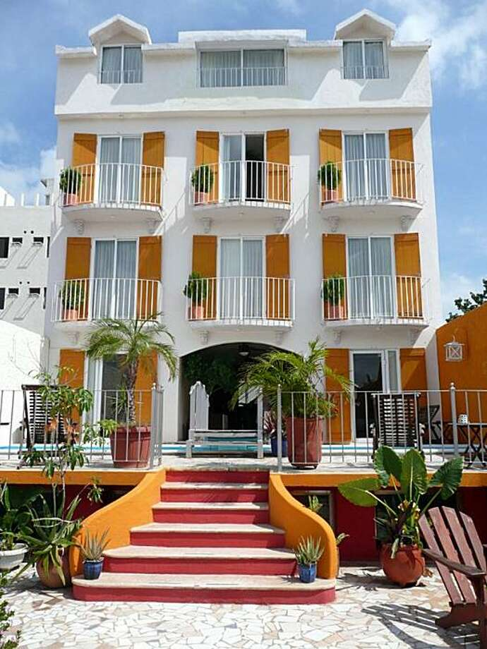 Hotel Sol y Luna: This pretty, vaguely Colonial, vaguely Victorian, and thoroughly contemporary boutique hotel stands at the corner of Parque Las Palapas, Cancun's de facto central square. A tapas and wine bar occupies the first floor. Photo: Christine Delsol, Special To SFGate