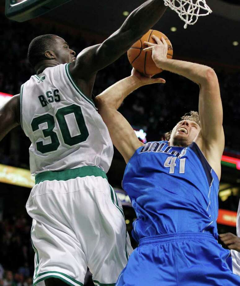 Mavericks forward Dirk Nowitzki scores as he's fouled by Boston's Brandon Bass in the final seconds of Dallas' win. Photo: AP
