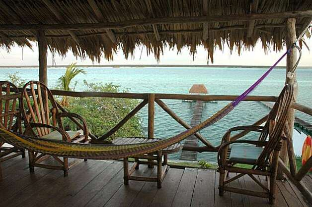 "Amigos B&B Laguna Bacalar has five rooms of various shapes and sizes overlooking the ""Lake of Seven Colors,"" which really does turn at least seven shades of blue in the course of a day. Photo: Christine Delsol, Special To SFGate"