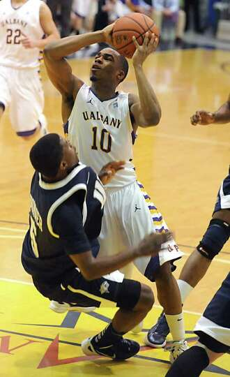 Mike Black of UAlbany is fouled by Jordon Bronner of New Hampshire as he drives to the basket during