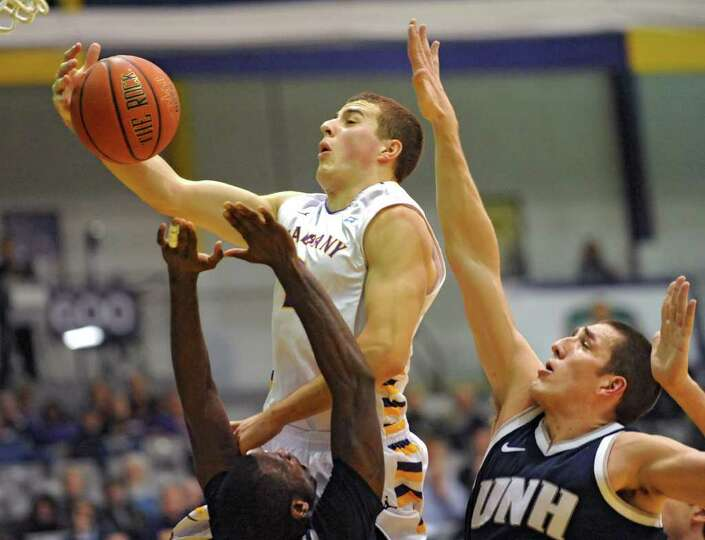 Logan Aronhalt of UAlbany drives to the basket during a basketball game against New Hampshire on Wed
