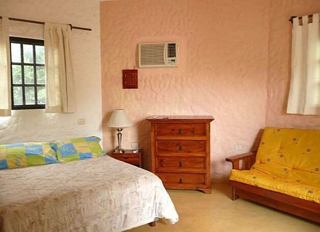 Rooms at Posada al Moroa feature simple, cheery furnishings and are flooded with natural light; sliding doors open onto balconies or the lovely small garden around a small swimming pool. Photo: Christine Delsol, Special To SFGate