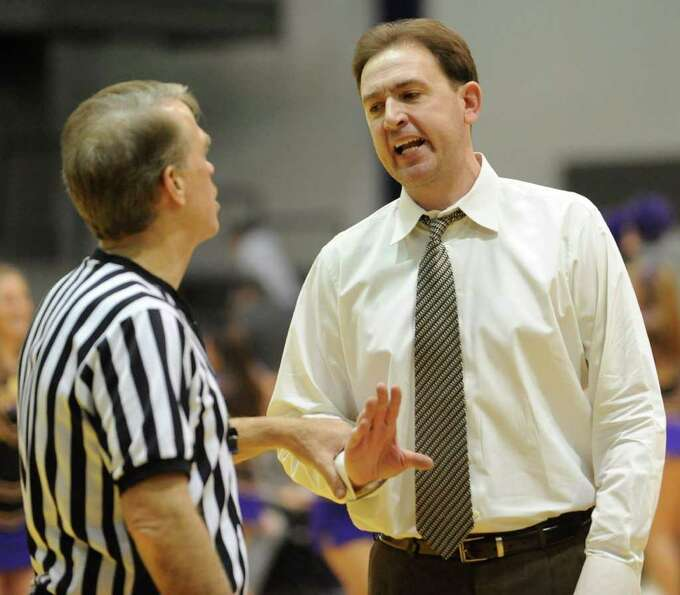 UAlbany head coach Will Brown has a word with the referee about an incident on the court during a ba