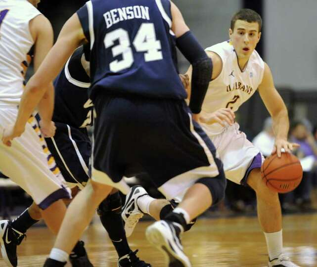 Logan Aronhalt of UAlbany dribbles the ball during a basketball game against New Hampshire on Wednes